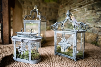 Lanterns with moss and fairy lights inside the Deer shelter at Canon hall.